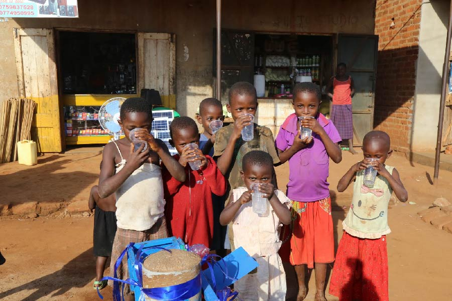children drinking fresh water